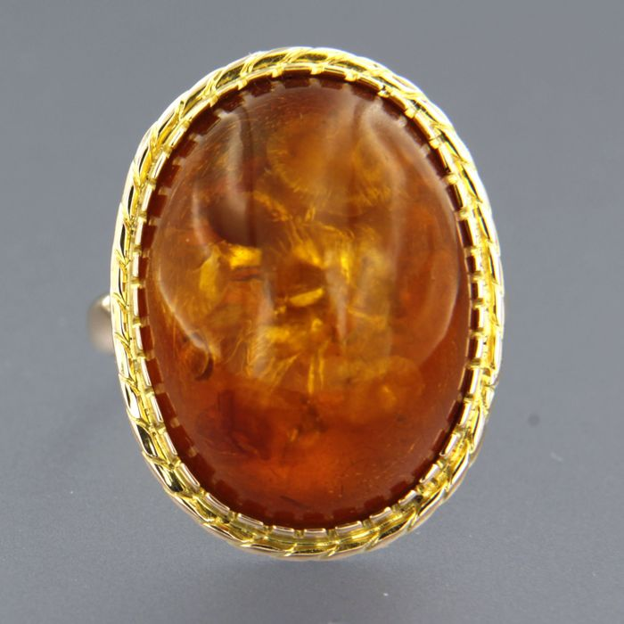 14 kt rose gold ring with oval cabochon cut amber, ring size 16.75 (53)