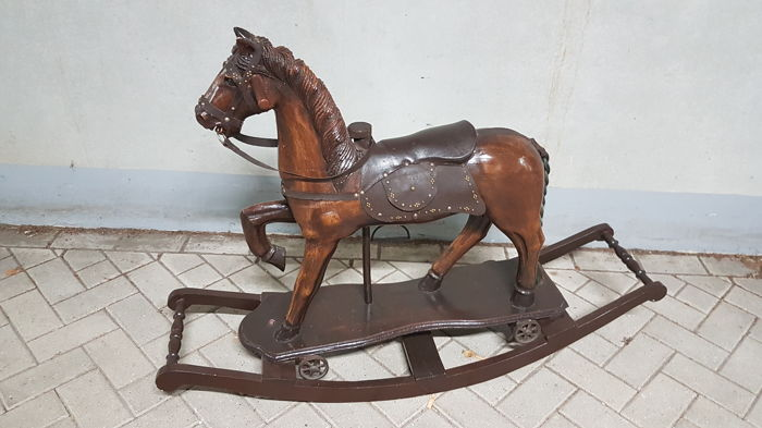 Wooden rocking horse - doubles as a pulling horse with wheels - 20th century