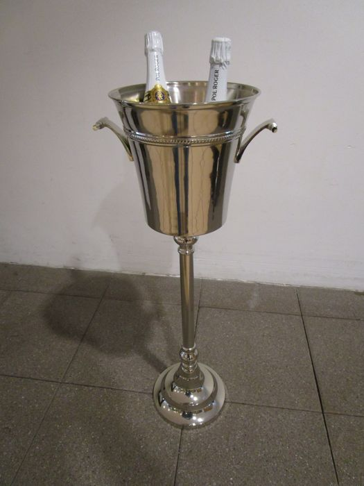 Luxurious silver plated Champagne cooler on foot.