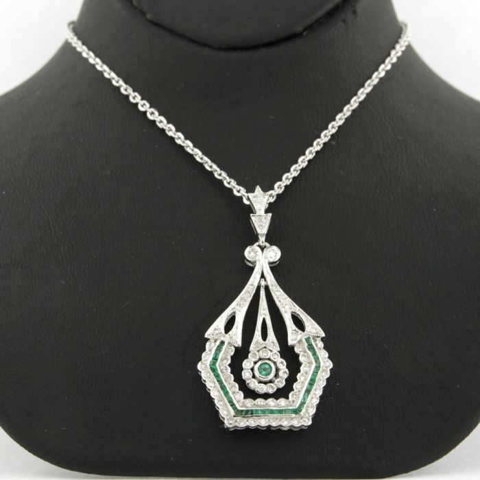 14 karat white gold necklace with a white gold pendant set with emerald and 73 single cut diamonds total approx. 0.38 carat