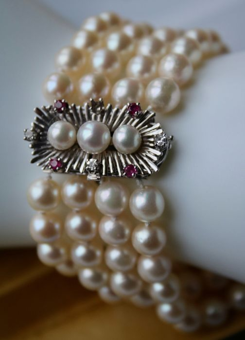 4-row bracelet 57.8gr. with round AAA Japanese Akoya pearls cream - pink excellent luster, approx. 6.8mm and 18kt./750 White gold lock with Rubies and diamonds.