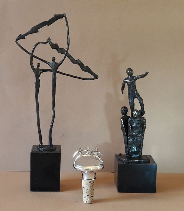 Corry Ammerlaan van Niekerk - A bronze sculpture, a bronze-plated sculpture (signed) and a silver-plated stopper