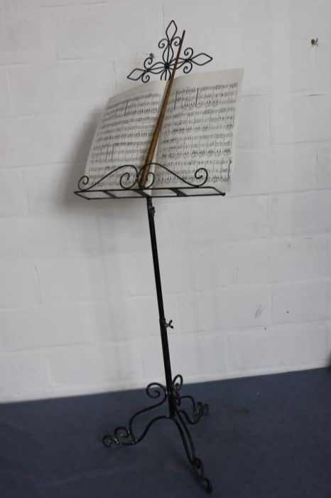 A graceful musical score stand and baton