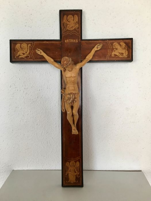 Crucifix - Jesus Christ in marquetry, protected by with symbolism.