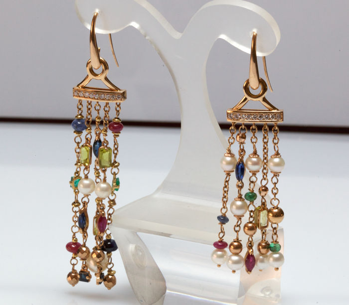 splendid dangling earrings in yellow gold with diamonds and precious stones