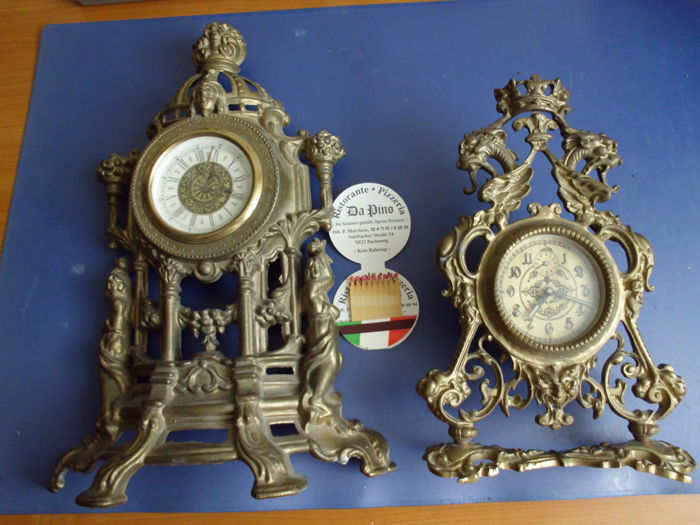 Two wall clocks.