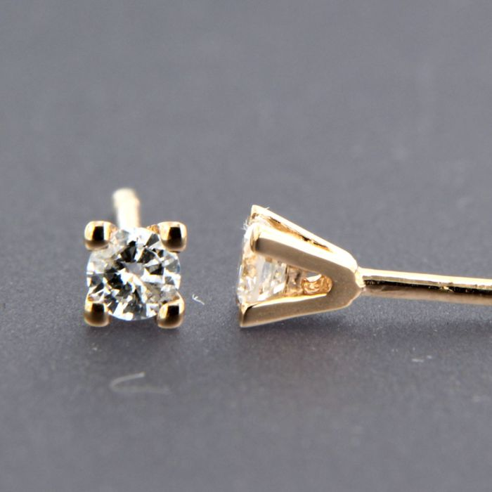 - no reserve price - 14 kt rose gold solitaire ear studs set with brilliant cut diamond approx. 0.24 carat in total - size: 3.6 mm wide