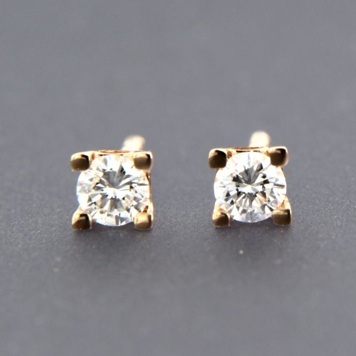 - no reserve price - 14 kt rose gold solitaire ear studs set with brilliant cut diamond approx. 0.10 carat in total - size: 3.1 mm wide