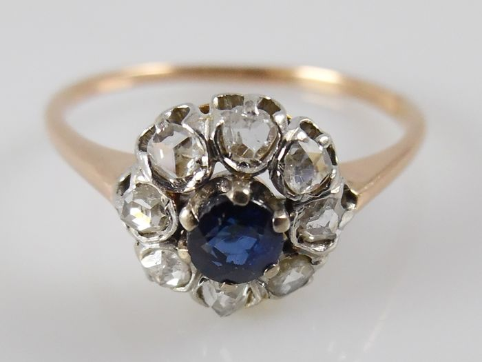 Rose gold entourage ring with 0.25 ct blue sapphire and 0.28 ct rose cut diamonds in platinum - ring size 56 (18 mm)
