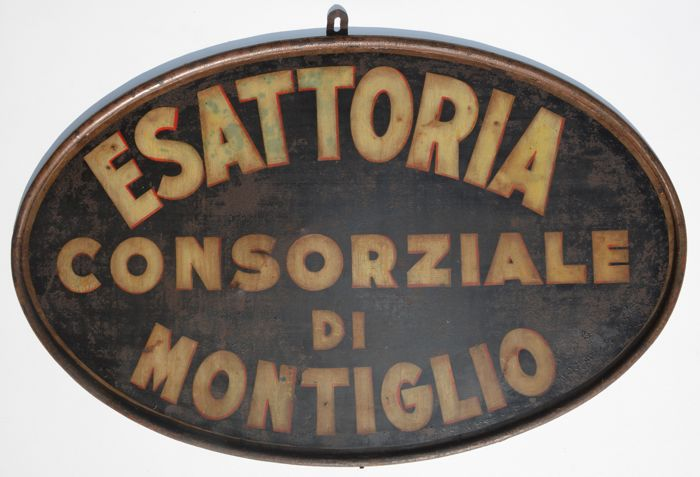 ESATTORIA CONSORZIALE DI MONTIGLIO - painted metal sign - Italy, 1930s/40s - 100% original, not a replica