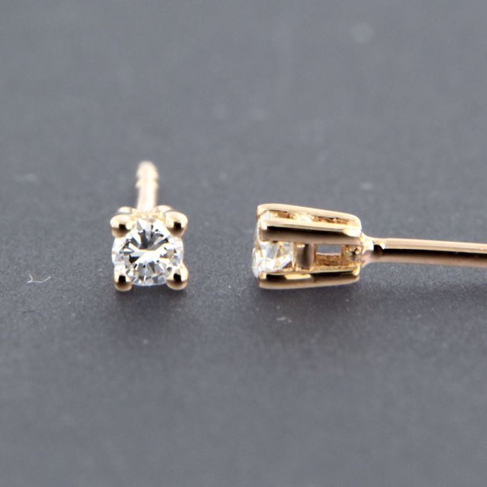 14 kt rose gold solitaire stud earrings set with brilliant cut diamond approx. 0.12 carat in total - size: 26 mm wide
