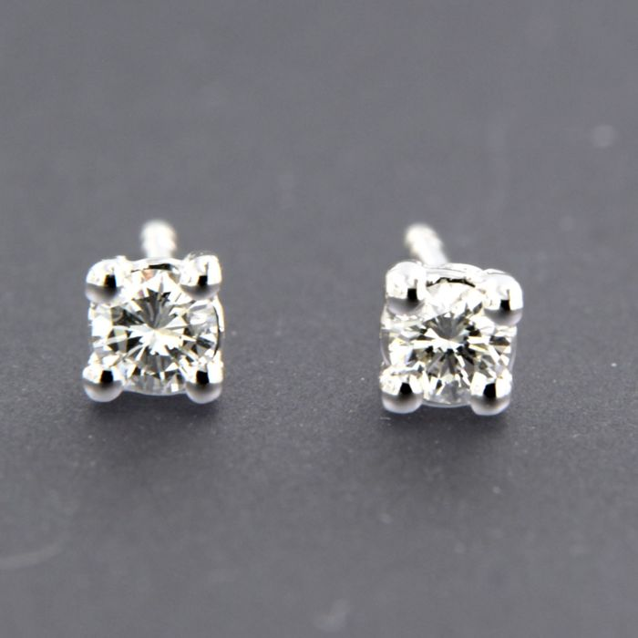 14 kt white gold solitaire stud earrings set with brilliant cut diamond, approx. 0.24 carat in total - size: 3.7 mm wide