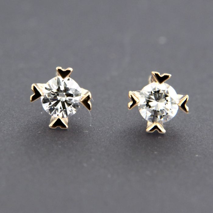 14 kt rose gold solitaire stud earrings set with brilliant cut diamond approx. 0.26 carat in total -  size: 4.8 mm wide