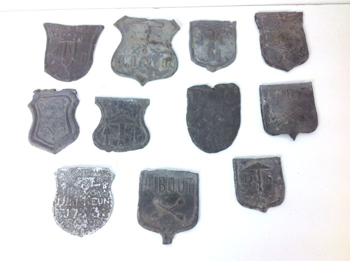 A collection with 11 antique lead cover-plates