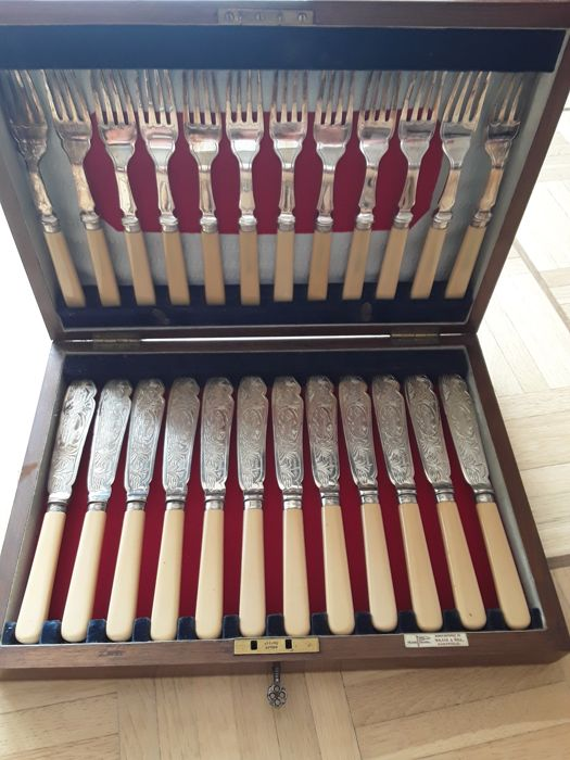 Silver fish cutlery in a wooden case