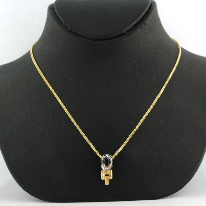 14 kt yellow gold necklace with a bicolour gold pendant set with a sapphire