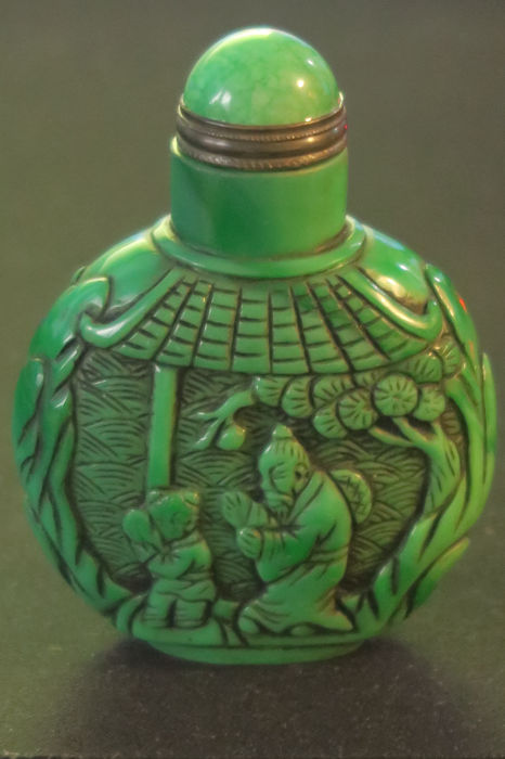Snuff bottle with older Chinese wise men and a child - from green glass - China 20th or 21st century