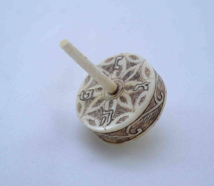 A carved bone spinning top or Dreidel -  Hand Paintings - Hannukah - Austria - 1920's