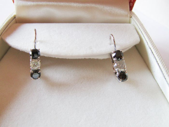 18 kt white gold earrings Trilogy with black diamonds totalling 1.80 ct and white diamonds totalling 0.70 ct New jewellery item Made in Italy