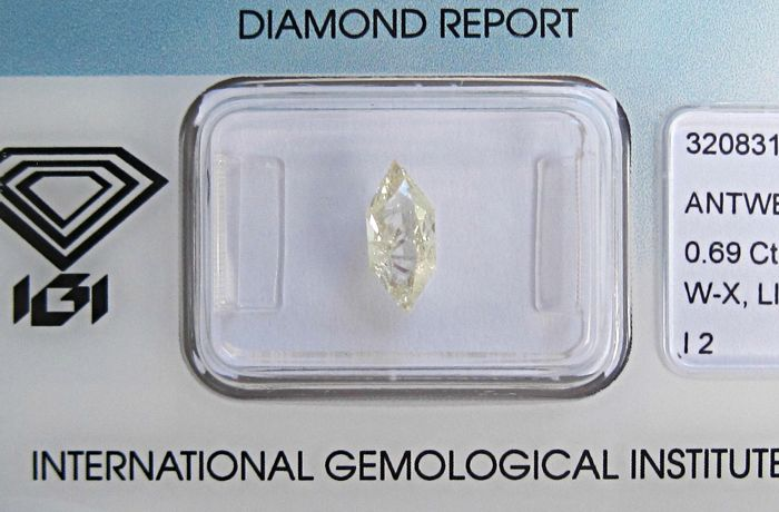 1 pcs Diamante - 0.69 ct - Brillante Hexagonal - W-X Light Yellow - I2