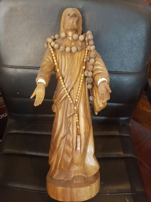Jesus in wood with open arms