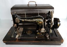 A rare Grirtzer sewing machine with wooden cover from the 1st half of the last century