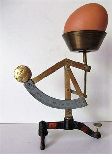 Vintage egg scale made of cast iron and brass