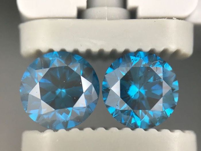 1.54 carat pair of  fancy DEEP blue round shape diamonds.