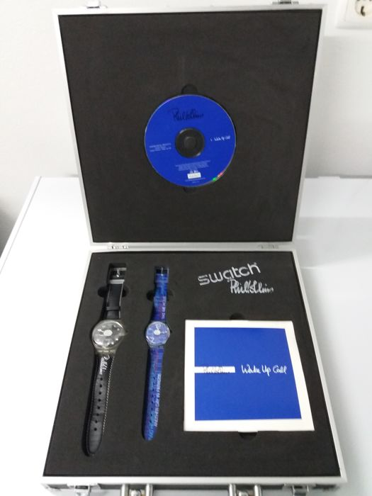briefcase with a Phil Collins Limited Edition cd and two swatch watches
