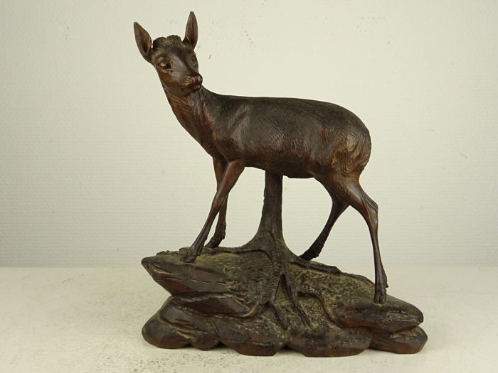 Wooden sculpture of a deer signed N. Deneffe - Brienz, Switzerland, early 20th century