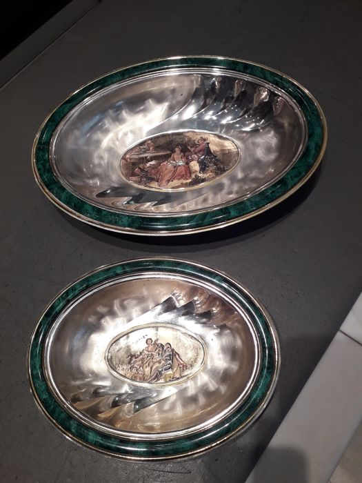 Pair of oval bowls made of plated metal and coated silver
