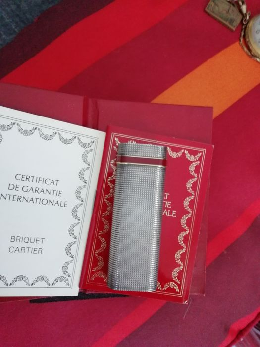 Silver plated Cartier lighter, guarantee and numbered
