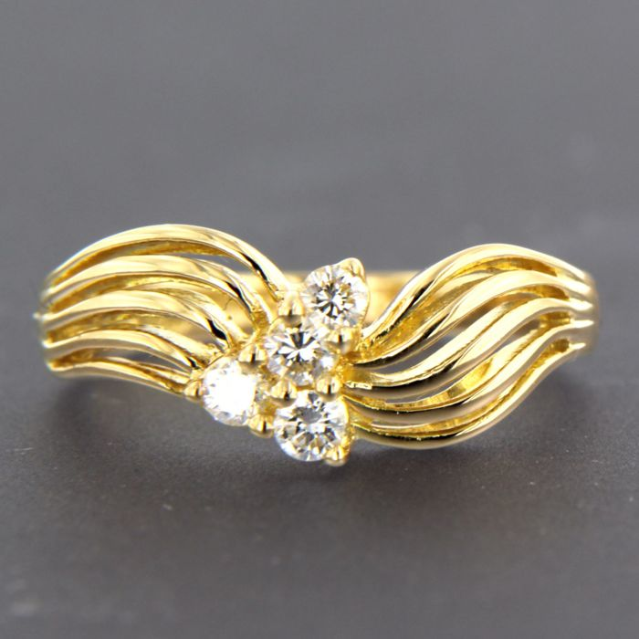 18 kt Yellow gold ring set with 4 brilliant cut diamonds, approx. 0.20 ct in total - ring size 17 (53)
