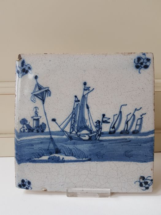 An antique tile with a rare representation of a Manned Frisian 'Zeilpraam' Sail, in a special landscape with a Light Beakon