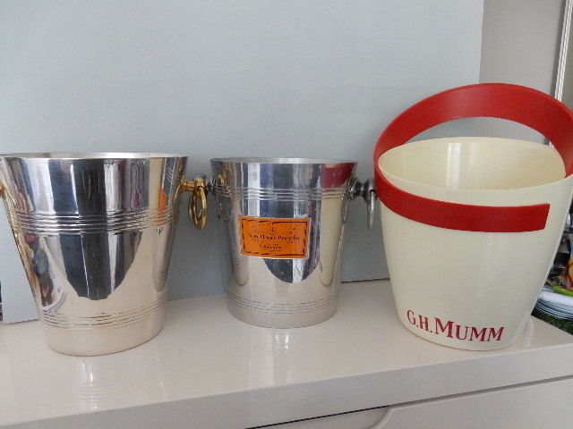 "Three superb Champagne chillers -  silver metal - handles in yellow copper - ""G.H. MUMM CORDON ROUGE "" -  ""VEUVE CLIQUOT PONSARDIN"" - 20th century -"