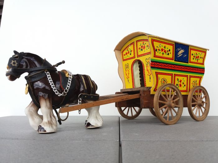 Shire horse with leather and brass / metal harnesses and handmade gipsy / tramp wood wagon
