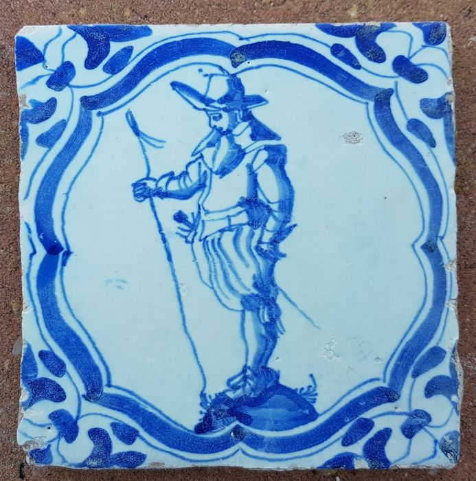 Tile with a depiction of a soldier in accolade