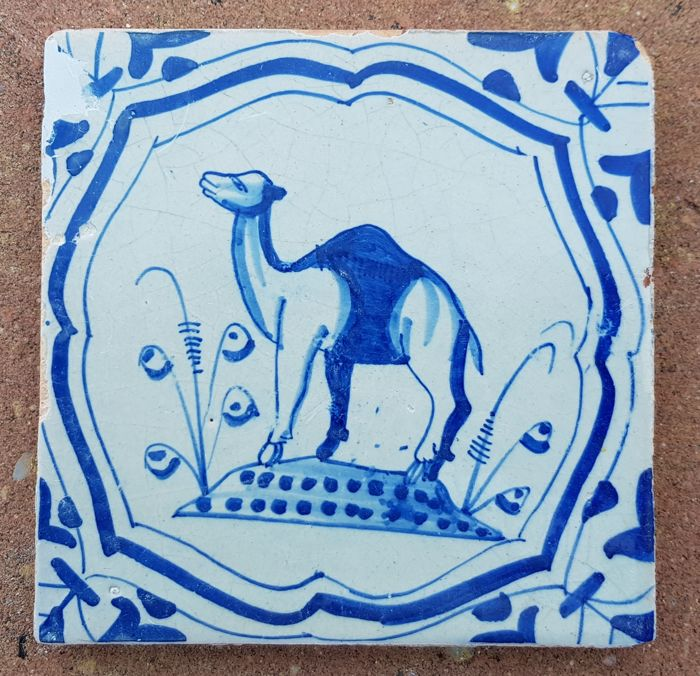 Tile with a dromedary in accolade