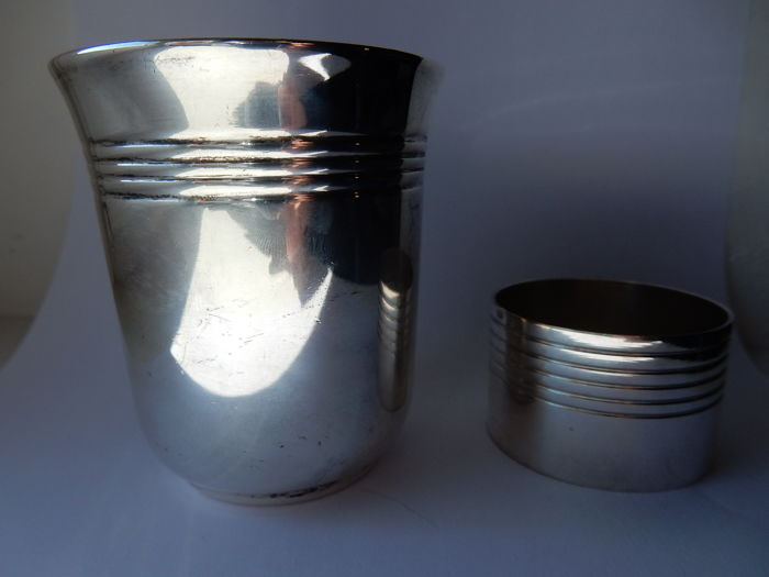 Metal tumbler and serviette ring by Christofle