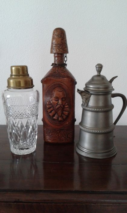 Three beautiful collectibles: one bottle (Spain) leather coated + antique shaker + pewter tankard