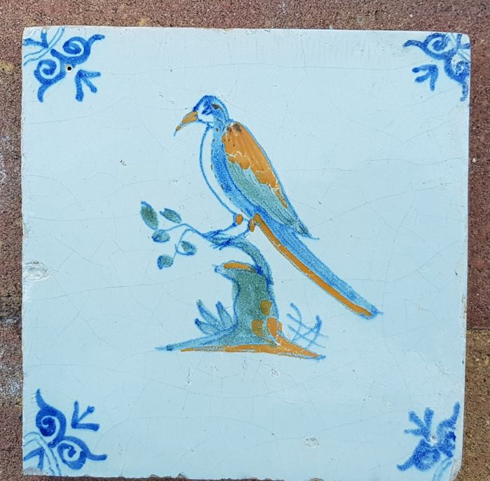 Multicoloured tile with a depiction of a bird on a branch, Holland, 1620-1640
