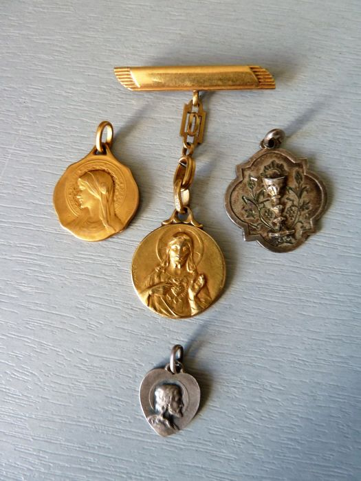 Set of four gold plated and silver medals