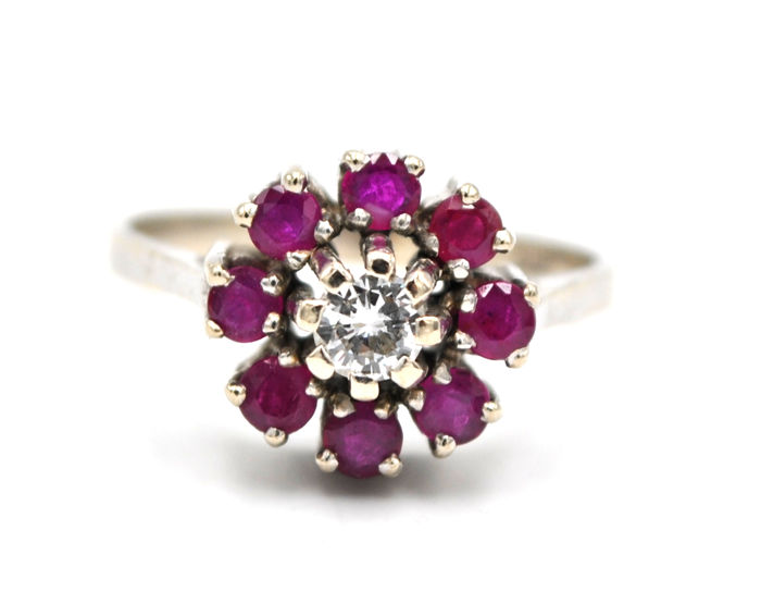 Ladies' ring set with rubies and a brilliant in 585 / 14 kt white gold