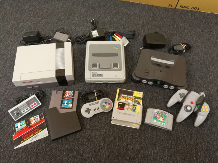 3 Generations of Nintendo Consoles with controller and Super Mario Games