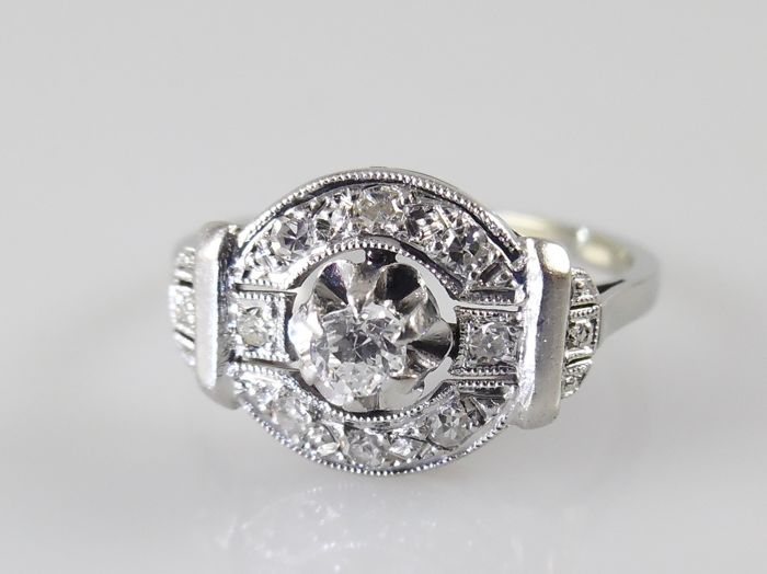 Platinum with white gold Art Deco ring with 9 diamonds G-VS, total 0.22 ct