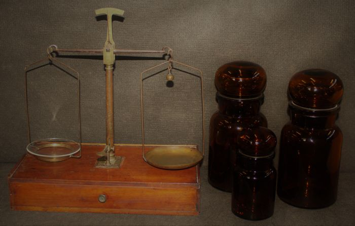 Antique apothecary scales with 3 pharmacists bottles