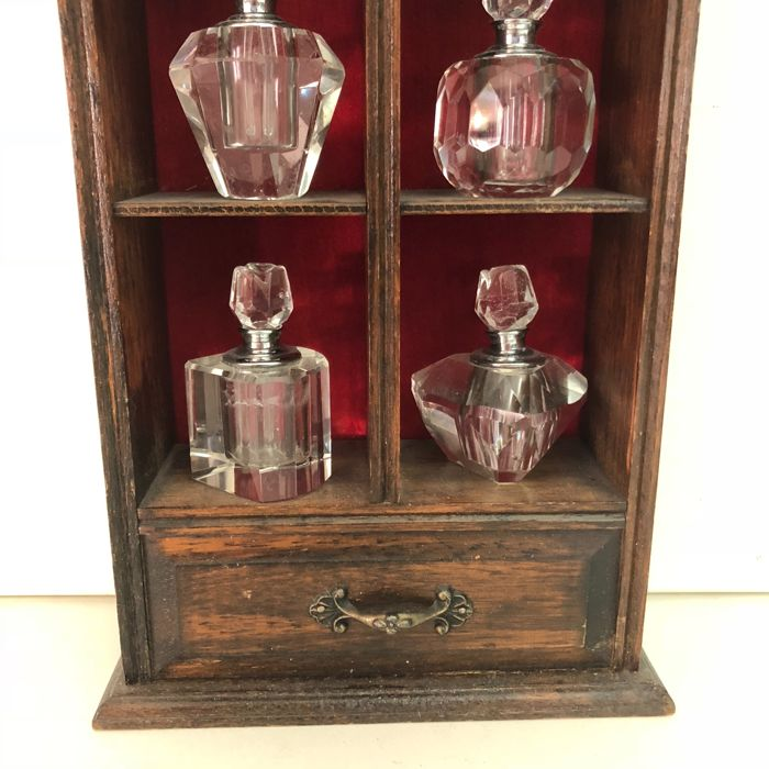 An Oak Wooden Cabinet Of Curiosities With Six Perfume Bottles