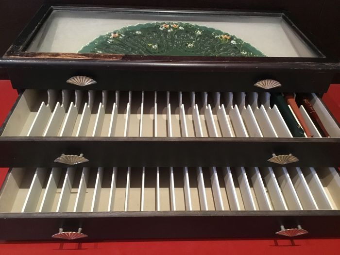 old and charming wooden display for fans with three drawers very good condition