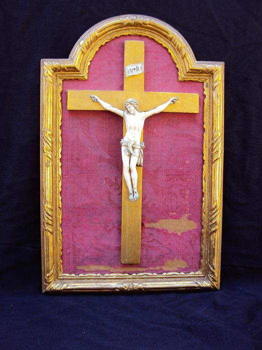 Ivory Christ on a gold leaf cross with wood and gold leaf frame - France - 19th century