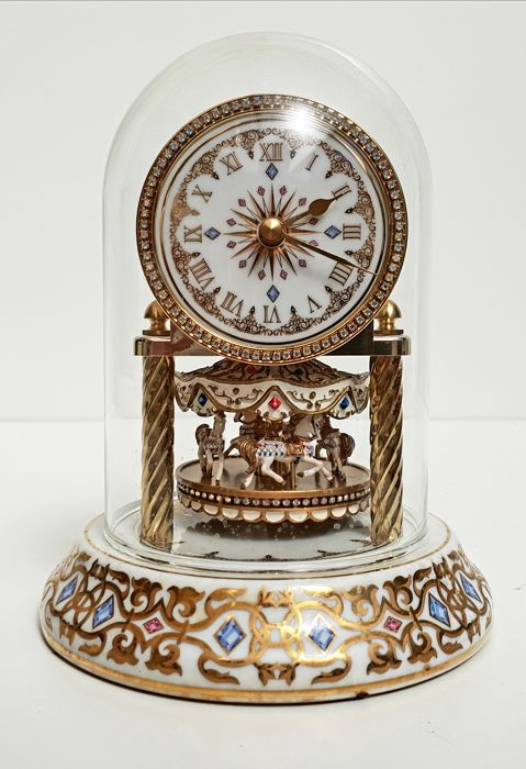 Luxurious Domed Porcelain Clock with Carrousel - Complete with 24 carat gold and over 100 Swarovski Crystals
